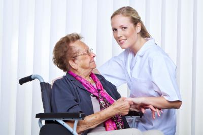 nurse and an elder woman in a wheelchair