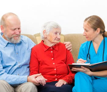 female nurse talking to the seniors
